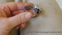 A simple hose clamp. Open the band using a screwdriver.