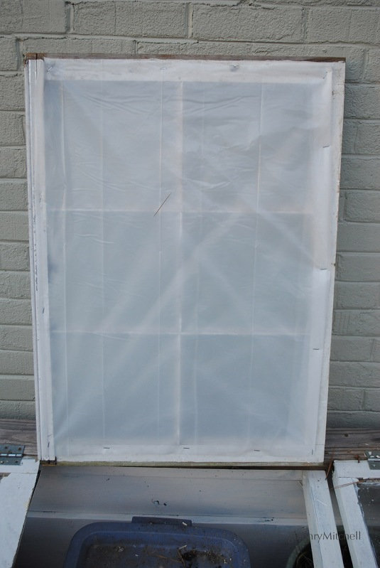 A double thickness of 3.5 mil plastic sheeting compensates for the broken glass panes.